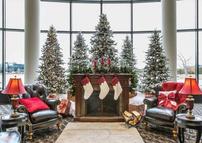 Flocked Christmas Trees in Fireside Holiday Scene